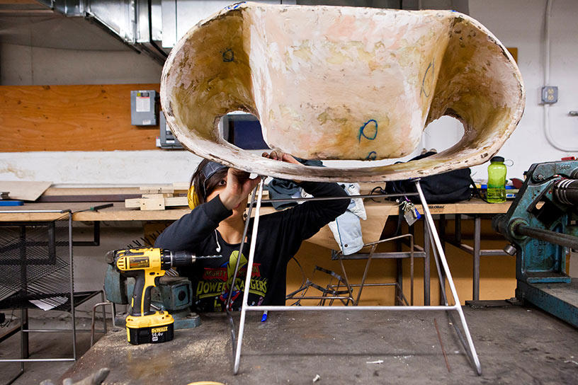A Furniture Design student works on a chair inside the department studios