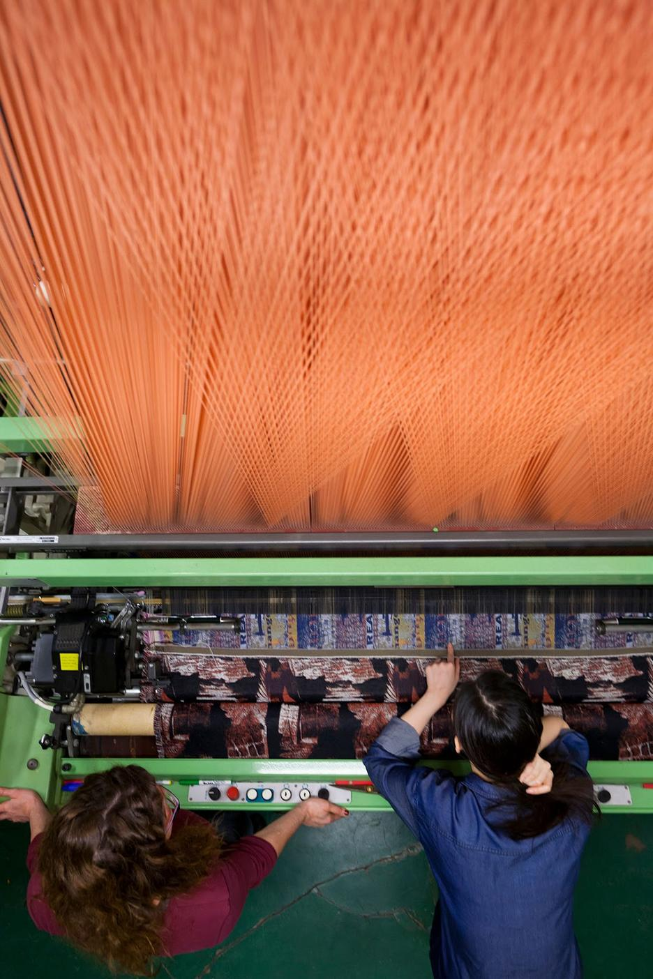 Students using jacquard loom.