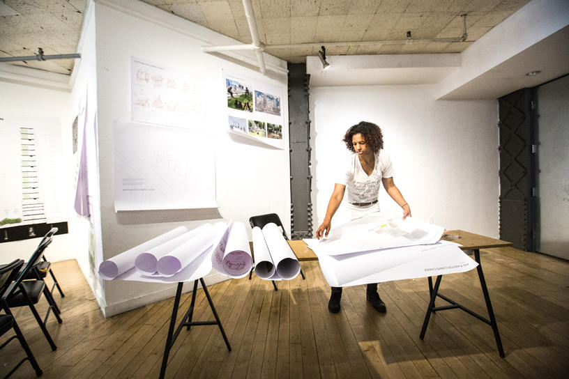 Architecture student unrolling work at BEB Gallery