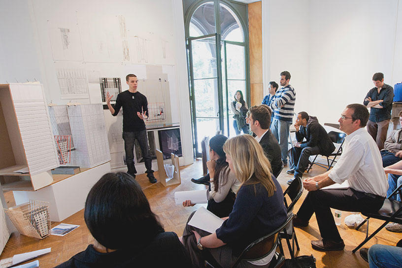 Architecture students and faculty participate in student work crit
