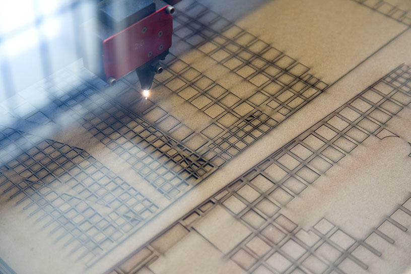 A laser cutter helps create an architectural model