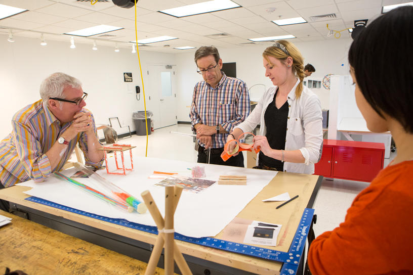 Furniture Design students and faculty members discuss concept drawings