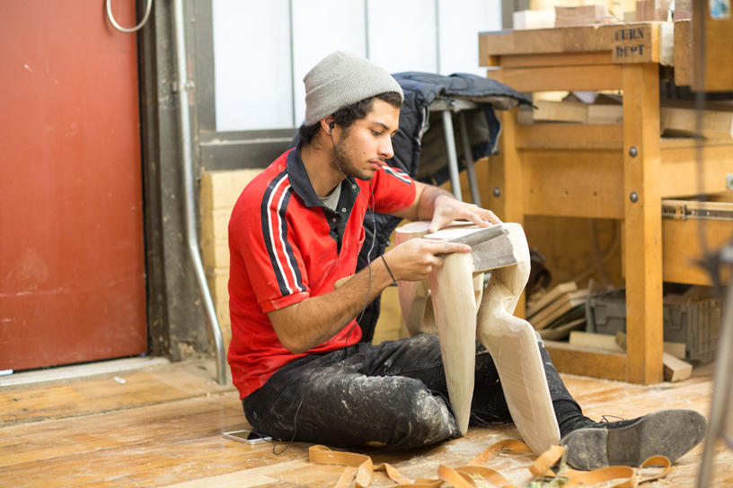 A Furniture Design student works on a project inside the studio