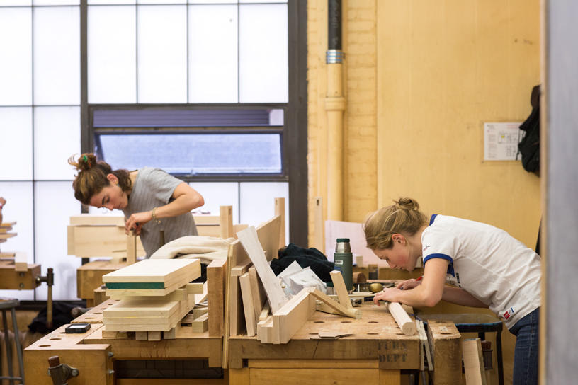 Two Furniture Design students at work on projects