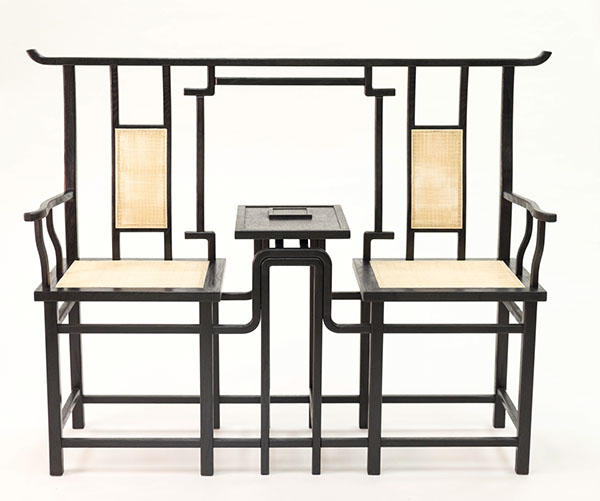 Two connected chairs made collaboratively by Furniture Design alums Ruobing Chen and Jiayin Feng