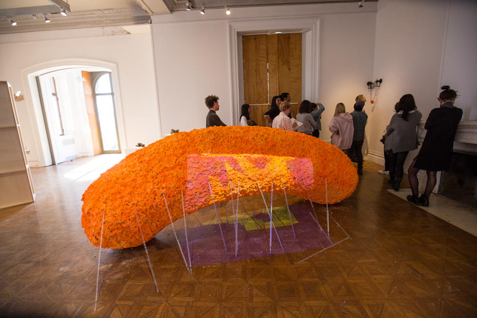 A sculpture of what appears to be a giant cheese puff snack.
