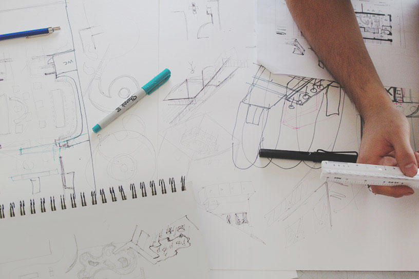 an Interior Architecture student measures sketch details