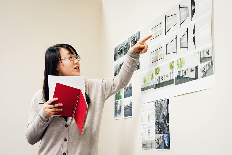 an Interior Architecture student presents work during crit