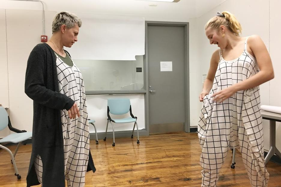 Interior Architecture students compare matching jumpsuits