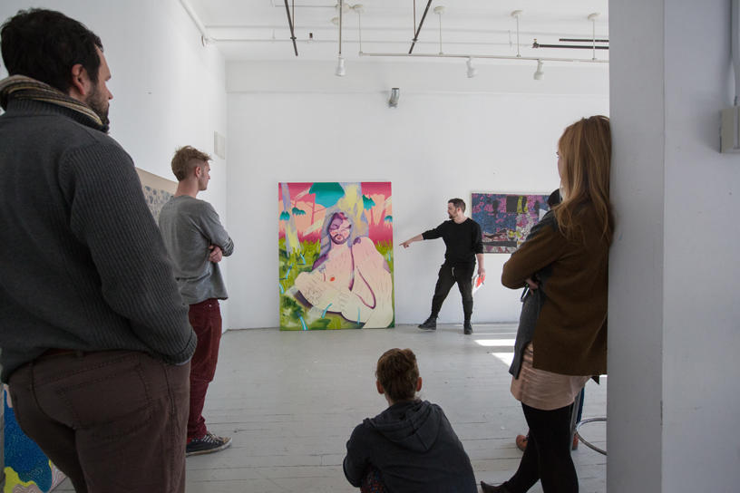 large painting being critiqued