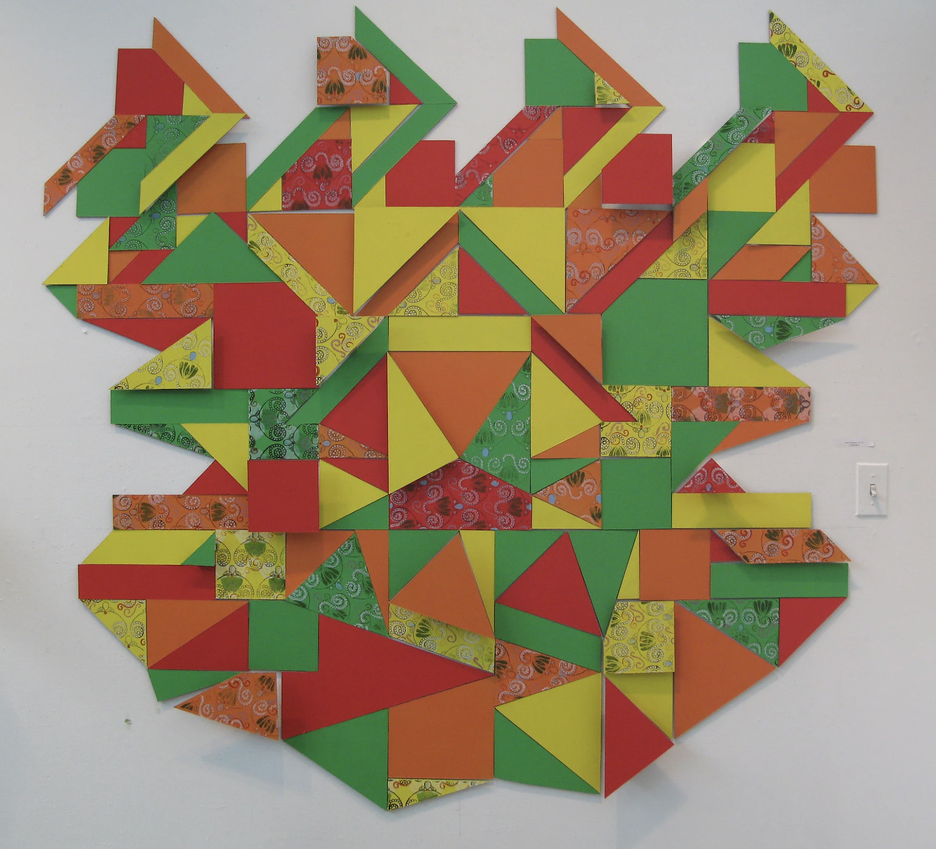 bright multicolored geometric student artwork on display