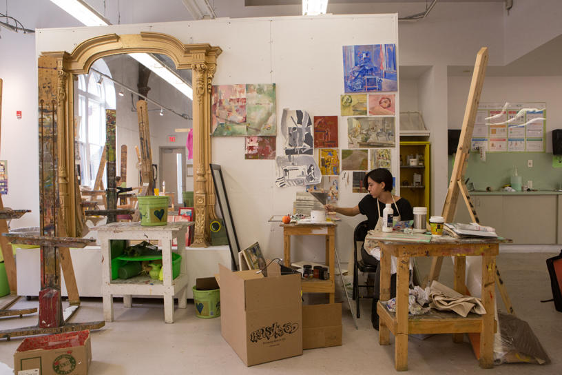 Painting studio with a large mirror