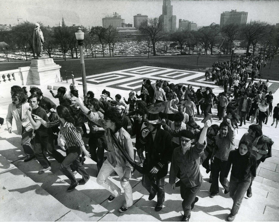Group of student protesters climbing the Statehouse steps